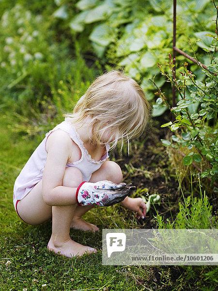 Girl seeding in garden