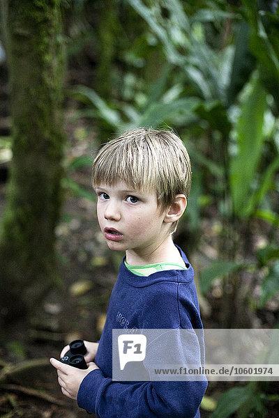 Portrait of boy holding binoculars
