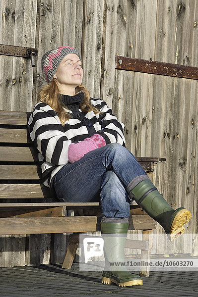 Woman relaxing on bench