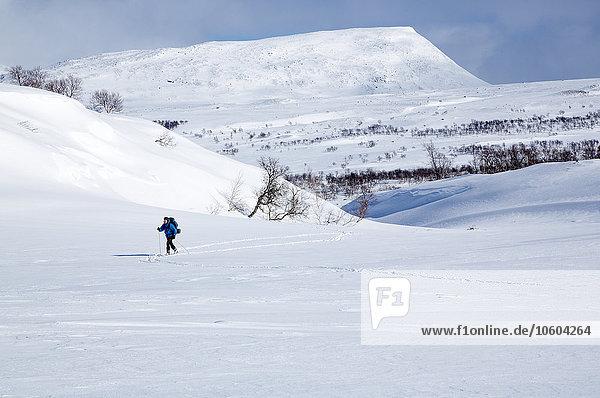 überqueren Mensch Skisport Kreuz