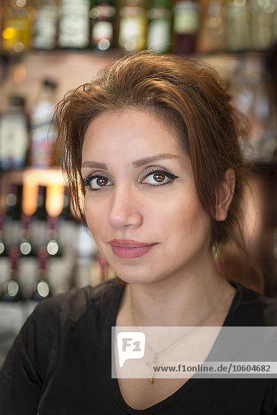 Portrait of young woman in bar