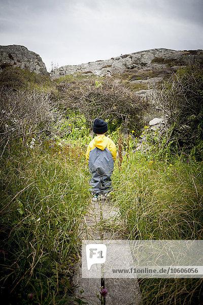Boy walking in meadow