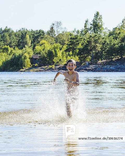 Boy running in water