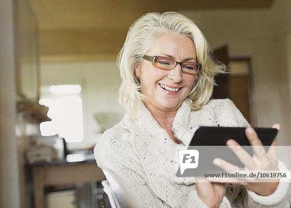 Smiling senior woman using digital tablet