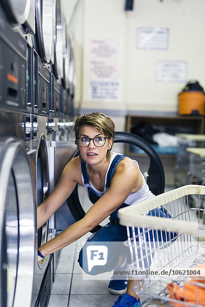 Portrait of blond woman in a laundry