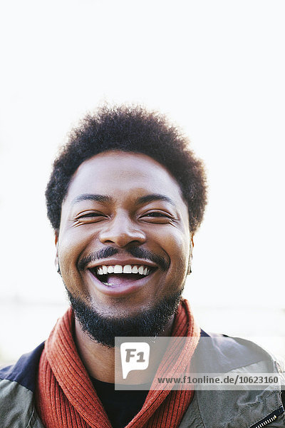 Portrait of laughing young man with