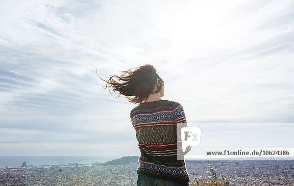 Spain  Barcelona  back view of woman looking at view from Turo de la Rovira