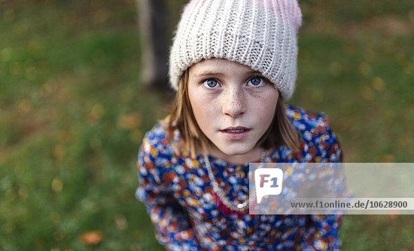 Portrait of girl wearing woollen cap looking up