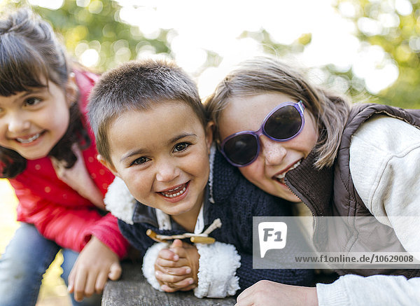 Three laughing children in a park