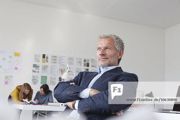 Businessman in office thinking