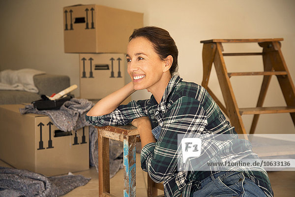 Smiling woman taking a break from moving house