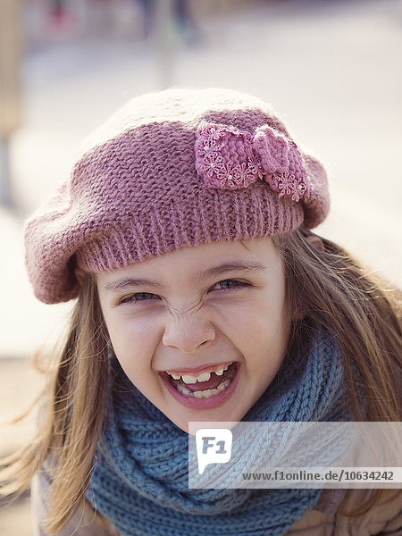 Portrait of laughing girl outdoors