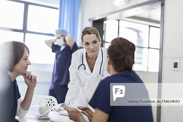 Doctors in hospital  discussing