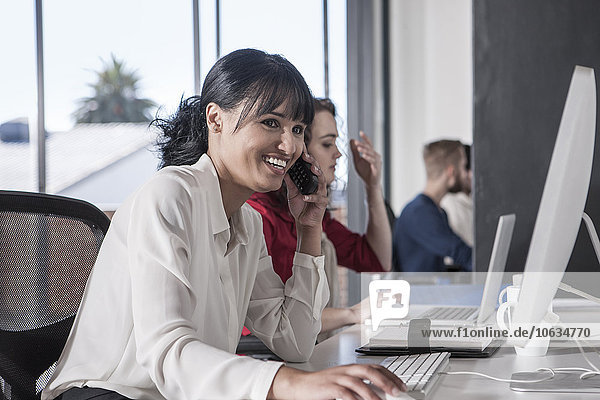 Woman in office talking on the phone