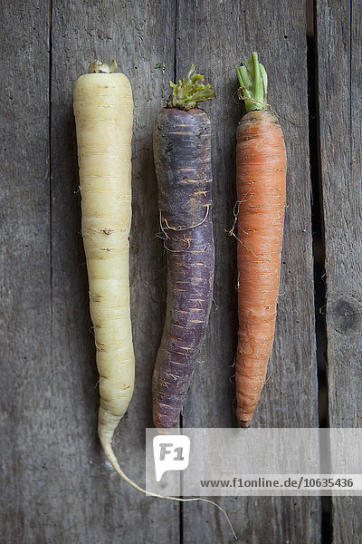 Close-up of radish and carrots on table
