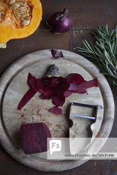 Directly above shot of beet with peeler on table