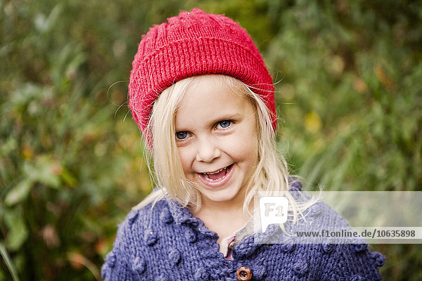Portrait smiling girl in forest