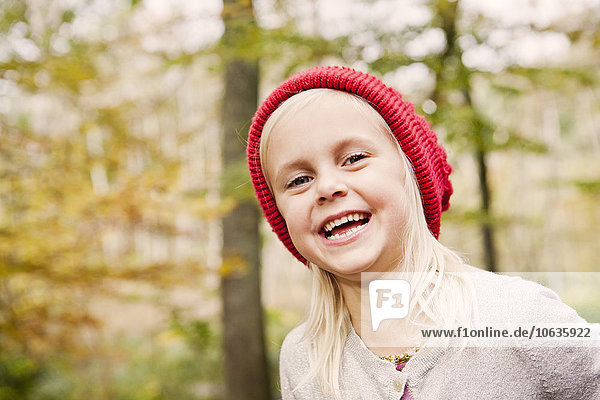 Portrait happy girl in forest