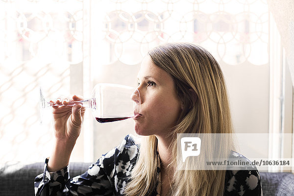 Woman drinking red wine at Lebanese restaurant