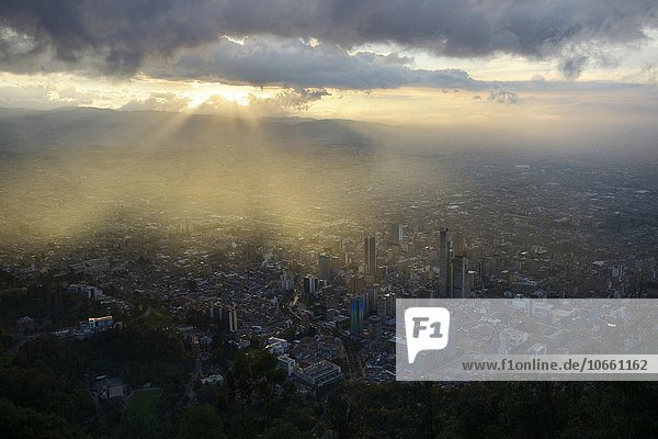 Sunset over city centre  Central Business District  and historic centre  view from Cerro Monserrate  Bogotá  Colombia  South America