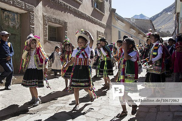 Traditionally dressed children in a festive procession during a Fiesta  Colquechaca in Potosi  Bolivia  South America