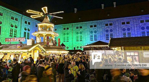 German Christmas market stalls  Christmas pyramid  illuminated buildings  Munich  Upper Bavaria  Germany  Europe