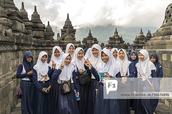 Muslim schoolgirl in uniform with headscarf  Buddhist temple complex Borobudur  Yogyakarta  Java  Indonesia  Asia