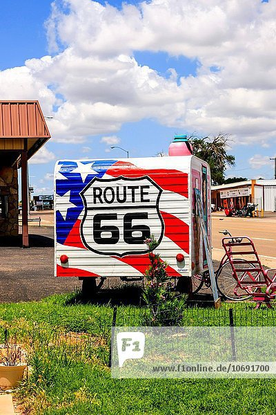 Route 66 sign and artwork on a travel trailer in downtown Tucumcari New Mexico.
