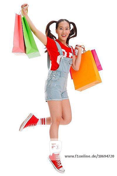 Tasche halten kaufen jung Mädchen