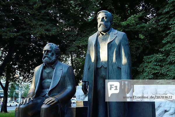 Karl Marx seated and Friedrich Engels statues by Ludwig Engelhardt in the Marx-Engels-Forum. Mitte District  Berlin  Germany  Europe.