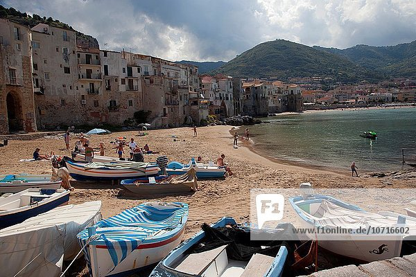 Scene from the the beach with the houses of the town at the background  Cefalu  Sicily  Italy  Europe.