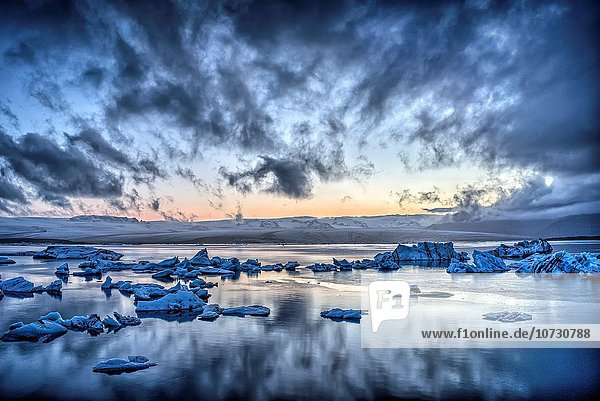 Midnight light at Jokulsarlon  a large glacial lake in southeast Iceland on the edge of Vatnajokull National Park. Situated at the head of the Breidamerkurjokull glacier  it developed into a lake after the glacier started receding from the edge of the Atlantic Ocean