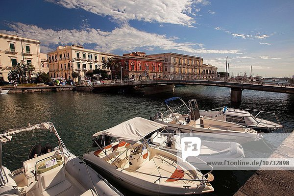 Boats in the harbor with the Venezian style buildings in the background  Ortigia Island  Syracuse  Sicily  Italy  Europe.
