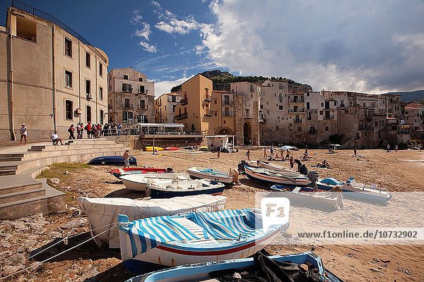 Scene from the the beach with the houses of the old town at the background  Cefalu  Sicily  Italy  Europe.
