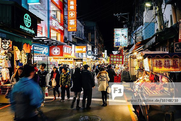 Taipei  Taiwan - The view of Shilin night market at night with many tourists.