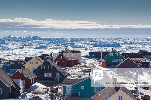 Greenland  Disko Bay  Ilulissat  elevated town view with floating ice.