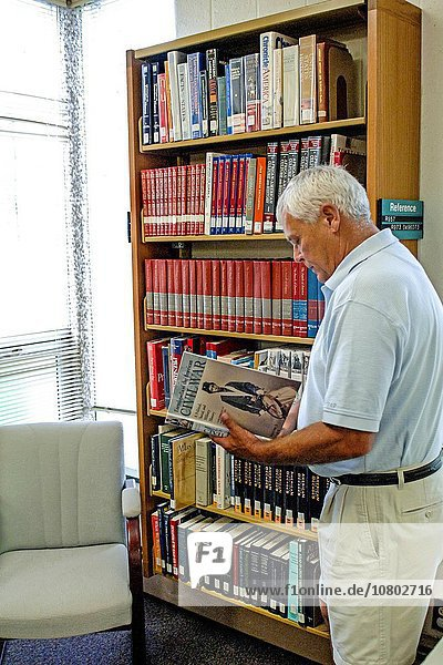A Man in a Library searching for a book.