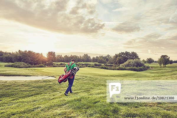 Golfer walking on course  Korschenbroich  Dusseldorf  Germany