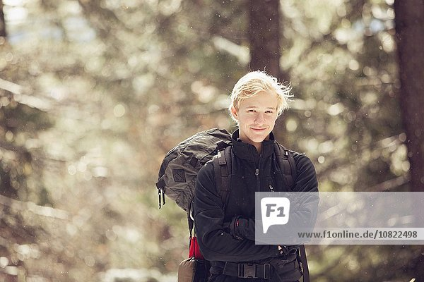 Portrait of young male hiker in sunlit forest  Ashland  Oregon  USA