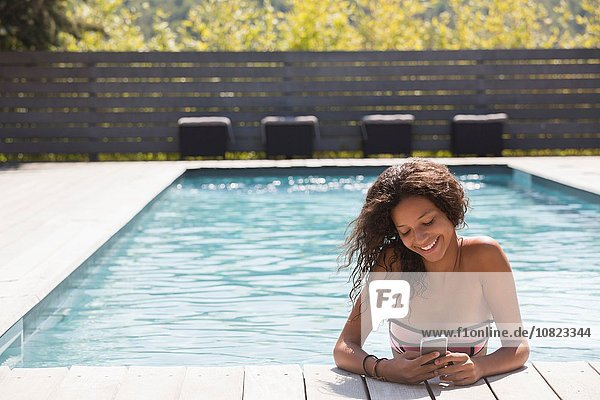 Girl in swimming pool reading smartphone  Cassis  Provence  France