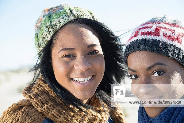 Portrait of two young women  outdoors  smiling