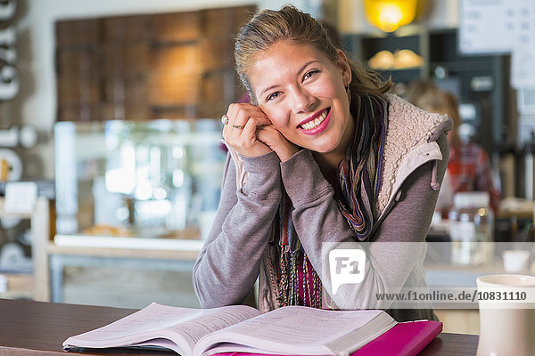 Mixed race student studying in cafe
