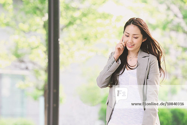 Japanese attractive businesswoman in downtown Tokyo