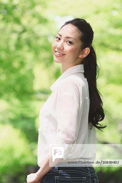 Japanese attractive woman in a city park