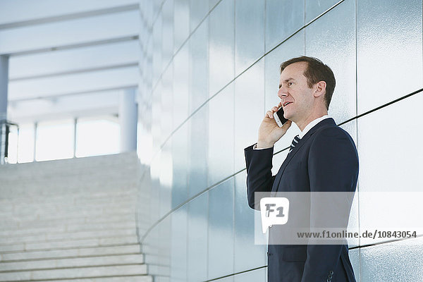 Caucasian businessman on the phone in modern office