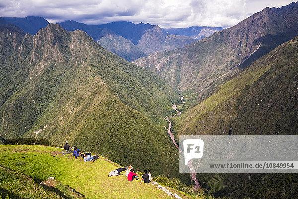 Tourists at Winaywayna Inca Ruins  on Inca Trail Trek day 3  Cusco Region  Peru  South America