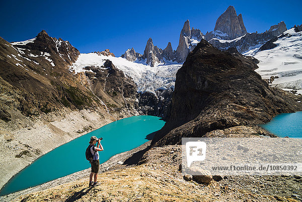 Hiker taking a photo of Mount Fitz Roy (Cerro Chalten)  El Chalten  Patagonia  Argentina  South America