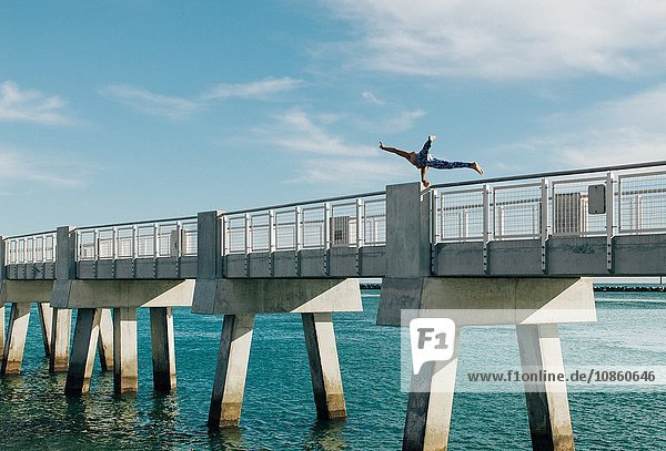 Mature man balancing on bridge  South Pointe Park  South Beach  Miami  Florida  USA