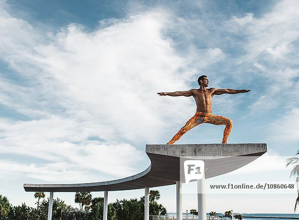 Mature man balancing on structure  South Pointe Park  South Beach  Miami  Florida  USA
