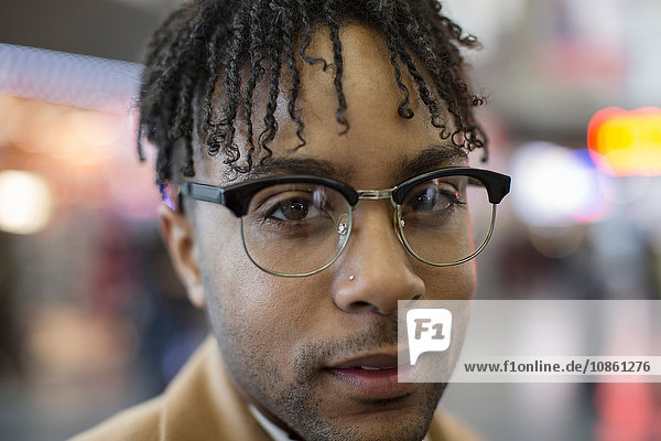 Close up portrait of young businessman in train station